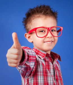 Kid giving thumbs up